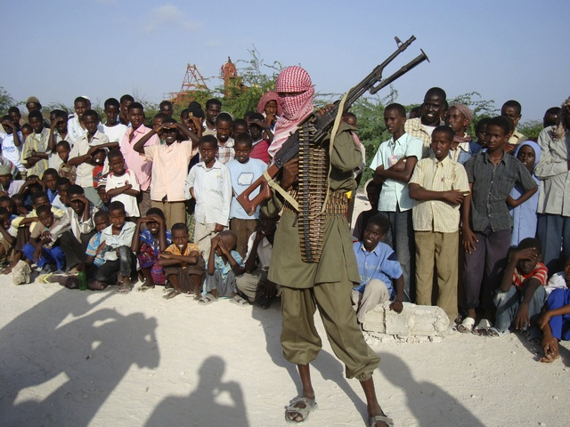 An Islamist fighter from Al-Shabaab Mujaahidin stands guard on the outskirts of Mogadishu
