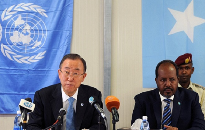 """UN Secretary General, Ban Ki-moon (L) and Somalia's President Hassan Sheikh Mahamud give a joint press conference on October 29, 2014 in Somalia's capital, Mogadishu. UN chief Ban Ki-moon warned on October 29, 2014 that Somalia risks returning to famine barring urgent aid, as he visited the war-torn country three years since more than 250,000 people died of hunger. """"Over three million Somalis are in need of humanitarian assistance and unfortunately that number is growing. I urge donors to step up contributions to avert another famine in Somalia,"""" Ban told reporters in the capital Mogadishu. AFP PHOTO/Mohamed ABDIWAHAB        (Photo credit should read Mohamed Abdiwahab/AFP/Getty Images)"""